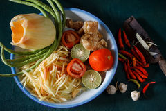 Ingredients set of papaya salad or Som Tum in Thai name. Local authentic cuisine of southeast asia: ingredients set of papaya salad or Som Tum in Thai name Royalty Free Stock Image