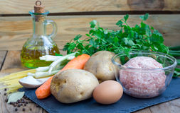 Ingredients for soup with meatballs and vegetables Royalty Free Stock Image