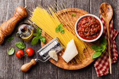 Ingredients for spaghetti bolognese. On gray wooden background Royalty Free Stock Image