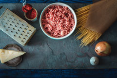Ingredients for spaghetti with meatball on the stone background top view Stock Image