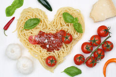 Ingredients spaghetti noodles pasta with heart Royalty Free Stock Photo