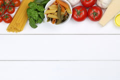 Ingredients for a spaghetti pasta noodles meal with tomatoes, ba Royalty Free Stock Image