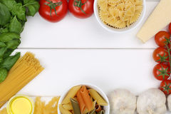 Ingredients for a spaghetti pasta noodles meal with tomatoes and Royalty Free Stock Images
