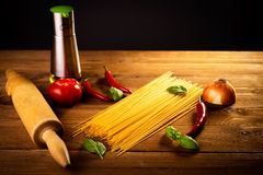 Ingredients for spaghetti on a wooden table Royalty Free Stock Photos