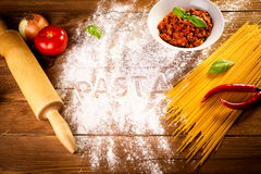 Ingredients for spaghetti on a wooden table Royalty Free Stock Photography