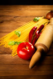 Ingredients for spaghetti on a wooden table Royalty Free Stock Images