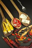 Ingredients for spicy barbecue on the wooden spoon. Dried chillies and spicy peppers filled with cheese. Stock Image
