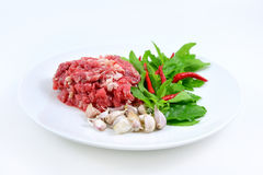 Ingredients of spicy fried meat with basil leaves. Ingredients of spicy fried meat with basil leaves on white background Stock Photo