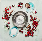 Ingredients for sweet cherry preserve,  jam or  jelly making, around empty cooking pot, top view Royalty Free Stock Images