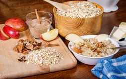Oatmeal Preparation. Ingredients on a table to prepare a hot bowl of oatmeal Royalty Free Stock Image