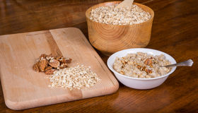 Fresh Cooked Oatmeal with Dry Oats and Nuts Stock Photo