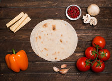 Ingredients for tacos or burrito making with copyspace. Ingredie Stock Photos