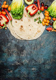 Ingredients for tacos : various fresh organic vegetables and tortillas on rustic background, top view Royalty Free Stock Photography
