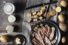 Ingredients for tartiflette on the wooden table Royalty Free Stock Image