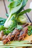 Ingredients for Thai tom yam soup. Laid out on a kitchen counter with tiger prawns, mushrooms, ginger, lemongrass, limes, celery, parsley and spices Royalty Free Stock Image