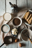 Ingredients for tiramisu on the  white wooden background Royalty Free Stock Images