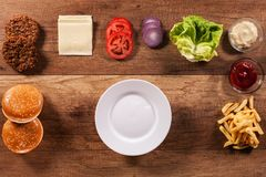 Ingredients to build the perfect hamburger - top view of wooden Royalty Free Stock Image
