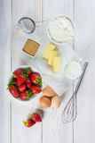 Ingredients to cook an strawberry cake Royalty Free Stock Images
