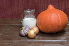 Ingredients to cooking  creamy pumpkin soup on the wooden table Stock Photography