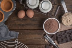 Ingredients to cooking muffins in a rustic setting on wooden tab Stock Image