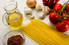 Ingredients to make a delicious organic tomato sauce with spaghetti royalty free stock photos