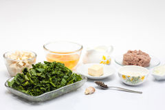 Ingredients to make the filling of a spinach and tuna quiche lorraine Stock Image