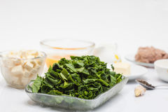 Ingredients to make the filling of a spinach and tuna quiche lorraine Stock Images