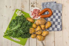 Ingredients to make typical dutch boerenkool with kale cabbage a Stock Photos
