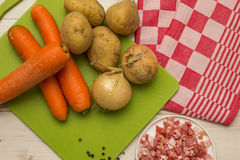 Ingredients to make typical dutch hutspot, with carrot, onion, a Stock Photos