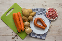 Ingredients to make typical dutch hutspot, with carrot, onion, s Stock Images