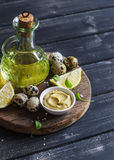 Ingredients to prepare homemade mayonnaise - olive oil, quail eggs, lemon, mustard. Stock Image