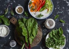 Ingredients to prepare vegetable rolls on dark background, top view. Stock Image