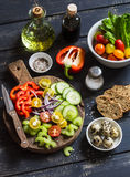 Ingredients to prepare vegetable salad - tomatoes, cucumber, celery, bell pepper, red onion, quail eggs,olive oil, balsamic vinega Royalty Free Stock Photo