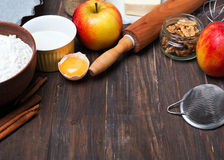 Ingredients and tools for making an apple pie Royalty Free Stock Photos