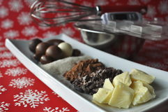 Ingredients and tools for making chocolates on winter background with snow flakes Royalty Free Stock Photography