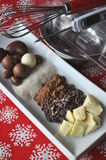 Ingredients and tools for making chocolates on winter background with snow flakes stock image