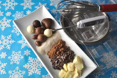 Ingredients and tools for making chocolates on winter background with snow flakes royalty free stock photo