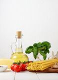 Ingredients for traditional italian dish - pasta bucatini with tomatoes, basil, cheese and olive oil. royalty free stock images