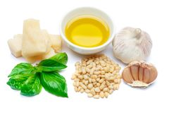 Ingredients for traditional italian sauce pesto isolated on white background. Top view Stock Images