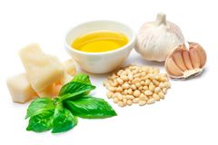 Ingredients for traditional italian sauce pesto isolated on white background. Top view Royalty Free Stock Photography