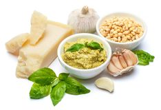 Ingredients for traditional italian sauce pesto isolated on white background. Top view Royalty Free Stock Image