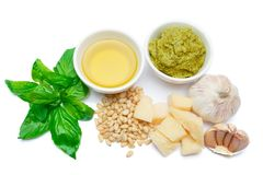 Ingredients for traditional italian sauce pesto isolated on white background. Top view Stock Image