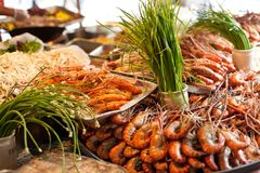 Ingredients for traditional thai cousine. And fresh seafood on fish market in Bangkok. Thailand Stock Photography