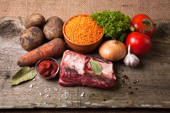 Ingredients for Turkey vegetable soup with red lentils, lying on Stock Photography