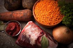 Ingredients for Turkey vegetable soup with red lentils, lying on Royalty Free Stock Photo