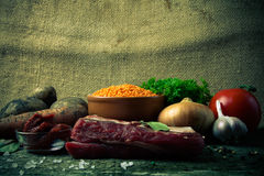 Ingredients for Turkey vegetable soup with red lentils, lying on Royalty Free Stock Image