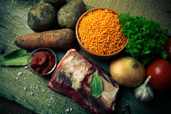 Ingredients for Turkey vegetable soup with red lentils, lying on Royalty Free Stock Photos