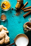 Ingredients for turmeric latte  on cyan background vertical Royalty Free Stock Images