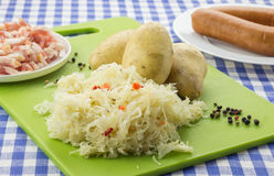 Ingredients for typical dutch dish zuurkool with sauerkraut and Royalty Free Stock Photo