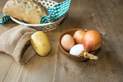 Ingredients Typical Spanish potato omelet Royalty Free Stock Photography